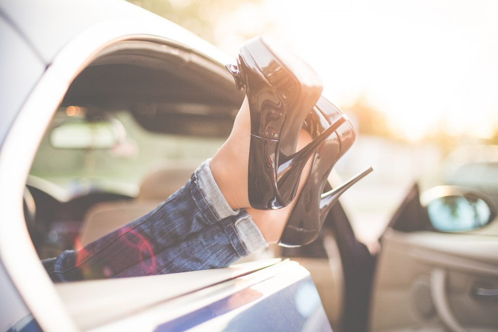 sexy-woman-legs-on-high-heels-out-of-car-windows-picjumbo-com