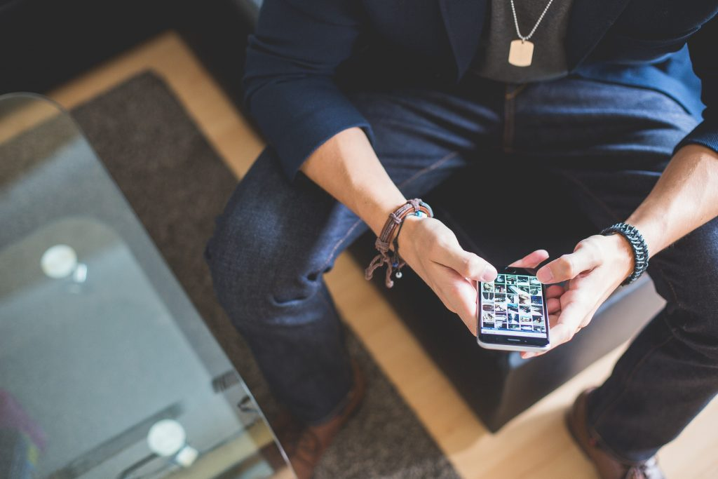 man-browsing-on-his-iphone-picjumbo-com